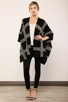 This poncho-inspired dolman cardigan is a timeless knit with an extraordinary potential to change your outfit into a superb one.  Turn the streets into your own runway in this chic piece featuring a open front, 3/4 dolman sleeves, high side slits, and an allover bold pattern with a marled knit construction.  <Cardigan / Poncho / Fall Fashion>