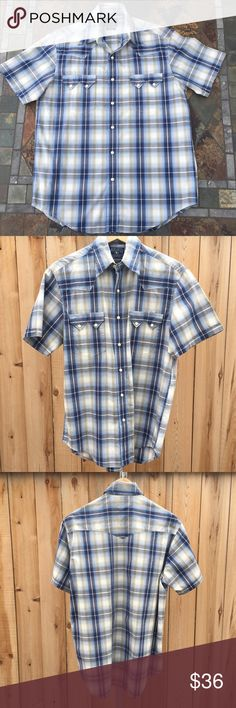 "Lucky Brand Western Shirt Short sleeve snap up western shirt has two front pockets. Both pockets have two metal with whit top snaps. Shirt snaps up until the last one on the collar which is a white button. Plaid colors are navy blue, light blue, white, light gray & a touch of light green. Measures 21"" pit to pit & 29"" long from shoulder to bottom of shirt. Content is 100% Cotton. In excellent condition with NO spots or damage. Lucky Brand Shirts Casual Button Down Shirts"