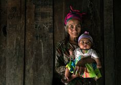 A Hmong grandmother and child in a mountain village near Luang Prabang, Laos.Paul Wager