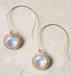 Opalescent facets shine from inside a border of pave rhinestones in these gorgeous earrings from Anthropologie.