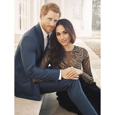 Prince Harry and Meghan Markle release official photos to mark their engagement. // This photo shot on the steps outside, shows the couple holding hands with Meghan's engagement ring taking centre stage.