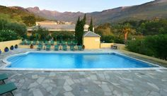 Castel Brando, Corsica France has an amazing outdoor swimming pool with totally stunning views across the French countryside. #travel #swimmingpool #hotel