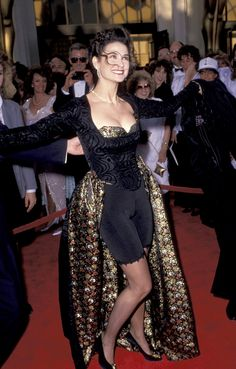 The Most Non‐Oscars Oscar Dresses of All Time: Demi Moore – Biker shorts were one of the most popular lower body coverings of the but it takes a truly bold woman to bring these Tour de France fashions to the biggest black tie affair of the season. Oscar Gowns, Oscar Dresses, Demi Moore, Robin Wright, Salma Hayek, Oscars Worst Dressed, Estilo Charleston, Celebrity Dresses, Celebrity Style