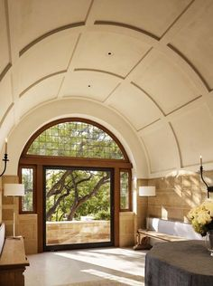 A barrel vaulted entry hall leads to a terrace, a private sunken garden off the master suite and a conservation park. Large steel framed glass doors at the end of the entry allow for ample light and provide an enticing glimpse of what's beyond. Unique Architecture, Interior Architecture, Interior Design, Interior Detailing, Barrel Vault Ceiling, Hut House, Hill Country Homes, Ceiling Design, Craftsman Style