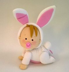 baby in a bunny suit cake topper