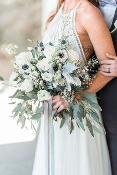 Eucalyptus, anemone and lamb's ear wedding bouquet. #naturalbouquet #romanticwedding #weddingbouquets