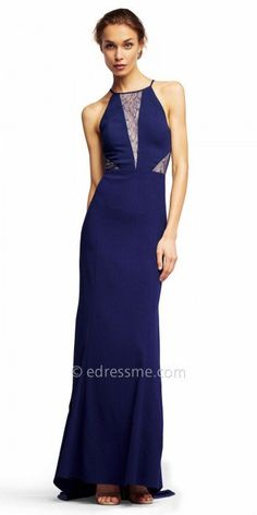 Dance the night away in this Lace Inset Sleeveless Evening Dress from Aidan by Aidan Mattox. This stunning style features a halter neckline with lace illusion insets down the center and at the sides. This gorgeous style also features a column silhouette with a slight high-low hemline and a sweep train. #edressme