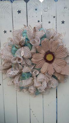 Large burlap flower wreath. Mesh, tan, turquoise.