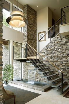 Contemporary staircase with a water feature underneath [Design: Alan Mascord Design Associates]