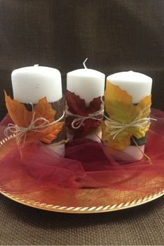 Here's a super easy and quick fall center piece idea.  Wrap strips of burlap around a pillar candle, tie a fall leaf on with twine or hemp cord, arrange on a gold charger with a bit of tulle.  Done!