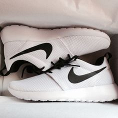 White NIkes with a black swoosh. These would go well with any outfit.