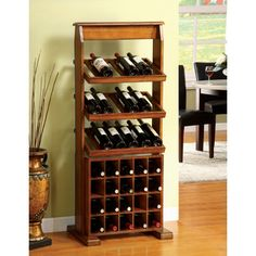 An elegant antique oak finish highlights this Sebastian wine rack. This hardwood rack holds up to 38 wine bottles and features a weathered, vintage appearance. This classically-styled wine rack is the