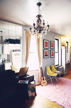 gray walls, cream curtains, colorful art