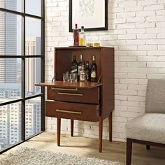 Clean lines and crisp details lend a modern air to the Jennings Mini Bar Cabinet. Wooden home bar cabinet has two drawers and a large flip-down storage area. Modern Home Furniture, Bar Furniture, Space Furniture, Wooden Home Bar, Mini Bar At Home, Small Bars For Home, Home Bar Cabinet, Bar Cabinets For Home, Corner Bar Cabinet