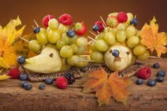 Food for children - two fruit hedgehogs Stock Photo