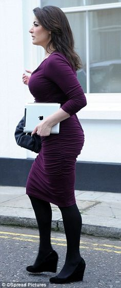 Add a splash of wine: Nigella Lawson covers her curves in grape colour dress as she attends book signing 24 oct 2012