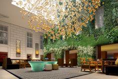 Hotel Palais, vienna - mkv design. glass sculptural lighting, live wall. Contemporary hotel lobby