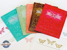 handmade notecard set ... tone on tone stamping of Ex Libris background stamp (new in-colors 2013-2015) ... vellum banner with stamped vellum butterfly ... Stampin' Up!
