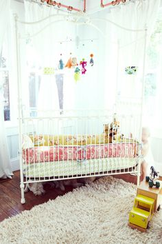 Mobile in canapyt is perfect. I love the iron canopy beds, but hate to leave them blank. The baby can't tear this down and get wrapped up in it like a fabric canopy.