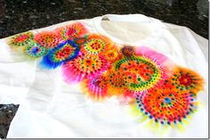 tie dye with sharpies. A drop of alcohol on each dot for dye to spread.