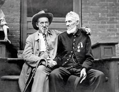 c. 1913  A veteran of the Union Army shakes hands with a Confederate veteran at the Gettysburg celebration, in Pennsylvania. How the last American Civil War veterans lived, loved and died.
