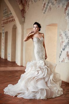 Mermaid gown with a jaw-dropping skirt. The dazzling design of the beadwork will make any bride stand out  for generations. Eddy K wedding dress.