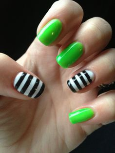 Green and striped gel manicure nails