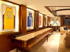 Man Cave Ideas and a Guide to a Successful Design - Man Cave Home Bar - Man Caves Basements Man Cave Diy, Man Cave Home Bar, Sports Man Cave, Shuffleboard Table, Framed Jersey, Ultimate Man Cave, Man Cave Basement, Family Room Design, Basement Remodeling