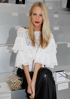 Beauty perfection: Poppy Delevigne gives a master class in minimalism (besides the pop of blood red of course!).