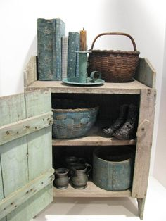 SMALL PRIMITIVE CUPBOARD IN BLUE PAINT.