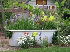 Always loved something like this in a garden. Reuse of items that were in the house. Good idea.