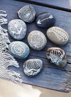 Sweet Paul's Sea Stones - simple craft project... draw on stones you find at the beach with a paint-pen... I love to use metallics!