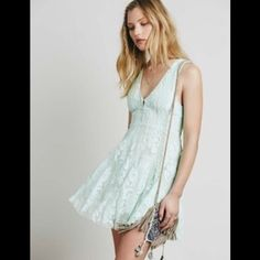 Free People mint lace dress Sleeveless version of FP fave Reign Over Me Dress, this deep V mini dress has a sheer mesh overlay with beautiful embroidery and scalloped trim. Hidden side zip. Lined. 122J469  RETAIL: $128 All sizes listed: 8( medium) and 10 (large)  ❤I have over 300 new with tag Free People items for sale! I love to offer bundle discounts!  ❤No trades. love the item but not the price? Submit an offer! Free People Dresses Mini