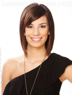 sleek-layered-brunette-cut-with-bangs