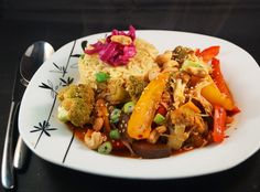 Stir Fry Vegetables with Szechuan Sauce served with Pineapple & Spring Onion Rice, Pickled Red Cabbage and Toasted Cashew Nuts