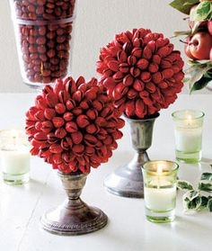 Recreate this beautiful high end decor for pennies on the dollar by shopping thrift stores for candle sticks, votives, and vases.