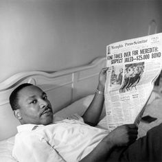 Dr. Martin Luther King, Jr. resting in the Lorraine Motel following the March Against Fear; reading the Memphis Press-Scimitar, Memphis, TN, 1966 © Dr. Ernest C. Withers, Sr. courtesy of the WITHERS FAMILY TRUST)