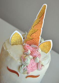 Look at this adorable unicorn cake topper. I love the combination of the rose gold and gold! Gorgeous!