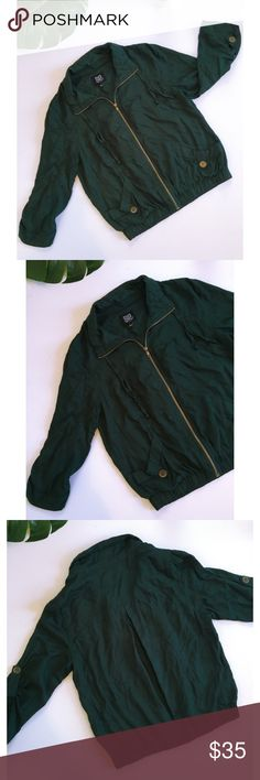 """Mine Forest Dark Green Lightweight Utility Jacket SO CUTE! Lightweight forest green jacket. Zip up. Stretchy around bottom. PLEASE NOTE before purchasing! This is labeled a large but runs VERY small- fits like a small! Listing under size small because it's nowhere close to a large. Measurements- 23"""" long, 19"""" armpit to armpit. mine Jackets & Coats"""
