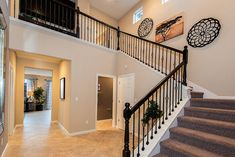 Open the front door to a gorgeous staircase!