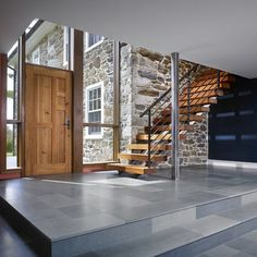 Something like this i could see. Just some simple design on wood Spaces Modern Mountain Front Doors Design, Pictures, Remodel, Decor and Ideas - page 33