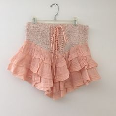 Free People Mini Skirt Light peach/pink mini skirt with gorgeous fabric. I love this skirt because it is very flattering and comfortable. Really cute with a plain white tank top and sandals or wedges to dress it up at night. Free People Skirts Mini