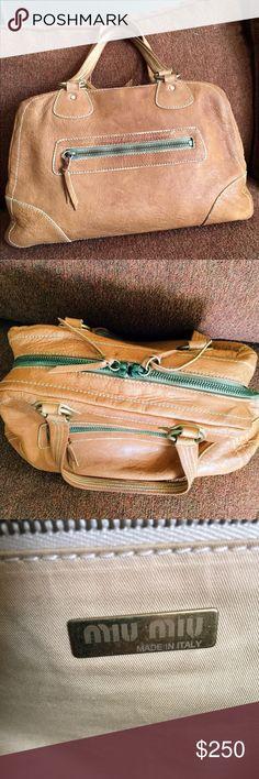 Miu Miu Camel Butter Soft Handbag Pre-loved butter soft Miu Mui handbag. Very clean inside! Dual zipper close on top. Medium size. Used, yet in beautiful condition. Miu Miu Bags Satchels