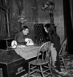 "morticiasgrandromance: "" ""John Astin and Carolyn Jones play chess during some downtime on the set of The Addams Family "" """