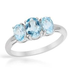 Wonderful Ring With  Topazes - Size 7.5  Size 7.5. Wonderful ring with topazes well made in 925 sterling silver. Total item weight 2.2g. Gemstone info: 2 topazes, 1.10ctw., oval shape and light blue color, 1 topaz, 1.00ctw., oval shape and light blue color.