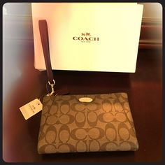 Coach Signature Wristlet/Clutch NWT, never used. Comes with Coach box. Handle and outside pocket are maroon patent leather. Card pockets inside. Coach Bags Clutches & Wristlets