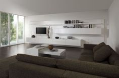Eleganz und grenzenlose Vielfalt bietet Ihnen diese individuelle Wohnwand. Bereichern Sie Ihr Wohnzimmer mit modernem und puristischem Design aus dem Hause KETTNAKER. Für Ihre Wohnwand können Sie zwischen verschiedenen Schränken und Sideboards mit viel praktischem Stauraum wählen. Mit einem passenden TV-Element und einem chicen Wandregal runden Sie das Wohnprogramm stilvoll ab. Dank einem umfangreichen Angebot von Zubehör kann die Wohnwand mit einer Beleuchtung und Einsätzen für CDs oder…