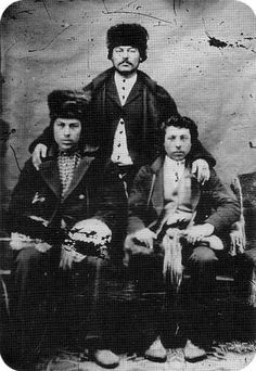 Josué Breland (standing) with companions; photographed at Red River, ca 1875.  Manitoba History: The Historiography of Métis Land Dispersal, 1870-1890