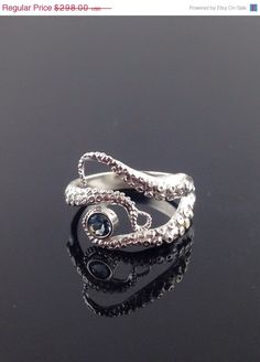 VALENTINE SALE Aquamarine Seductive Tentacle Ring, Sterling Silver, Engagement Ring, Wedding Band, Octopus Jewelry by OctopusMe on Etsy https://www.etsy.com/listing/186612747/valentine-sale-aquamarine-seductive