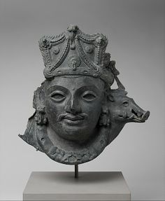 Mask of Vishnu as Para Vasudeva Date: 5th century Culture: India (Jammu and Kashmir) Medium: Bronze Dimensions: H. 13 1/4 in. (33.7 cm); W. 12 1/2 in. (31.8 cm); D. 5 in. (12.7 cm) Classification: Sculpture Credit Line: Gift of Donald and Polly Bruckmann, 2004 Accession Number: 2004.177